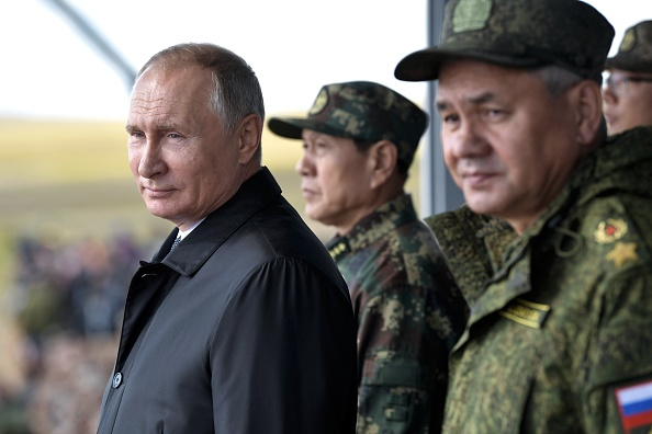 Russia's President Vladimir Putin (L), China's Defense Minister Wei Fenghe (C) and Russian Defence Minister Sergei Shoigu watch the parade of the participants of the Vostok-2018 (East-2018) military drills at Tsugol training ground not far from the Chinese and Mongolian border in Siberia, on September 13, 2018. (Getty)