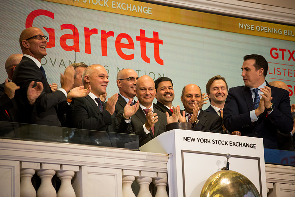 Olivier Rabiller, president and chief executive officer of Garrett Motion Inc., center, rings a the opening bell celebrating the company's spin off from Honeywell International Inc. on the floor of the New York Stock Exchange (NYSE) in New York, U.S., on Monday, Oct. 1, 2018. U.S. stocks rose toward records, while the Canadian dollar and Mexican peso gained after negotiators agreed to a new version of the Nafta trade pact. (Getty)
