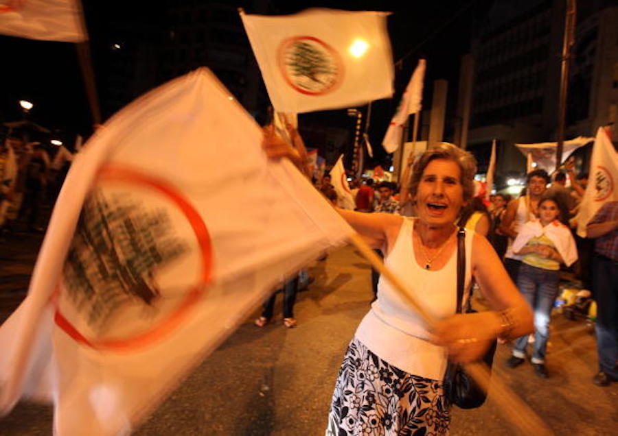 A supporter of the anti-Hezbollah Christian Lebanese Forces party celebrates in the Beirut Christian stronghold of Ashrafieh late on June 08, 2009. (Getty)