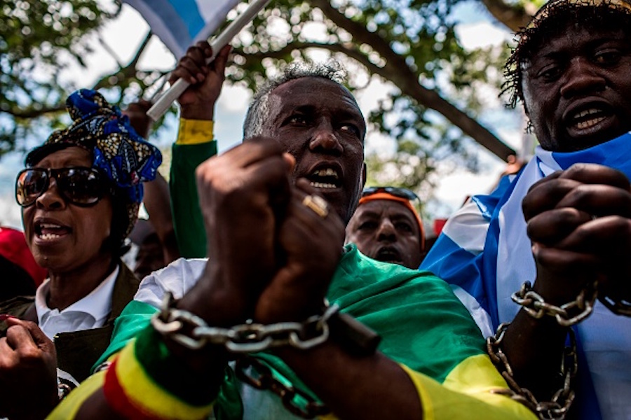 Members of the Africa Diaspora Forum (ADF), civil society organisations, churches, trade unions and other coalitions wear chains and shout slogans during a demonstration against the slave trade and human trafficking in Libya on December 12, 2017 at the Union Buildings in Pretoria. (Getty)