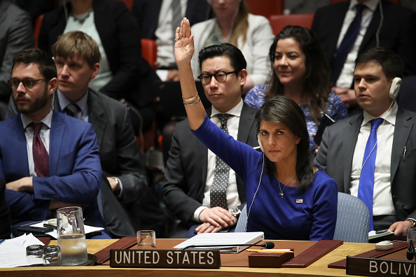 United States Ambassador to the United Nations Nikki Haley vetoes a Russian proposed draft resolution that would 'condemn the aggression against Syria by the U.S. and its allies' during a United Nations Security Council emergency meeting concerning the situation in Syria, at United Nations headquarters, April 14, 2018 in New York City. (Getty)