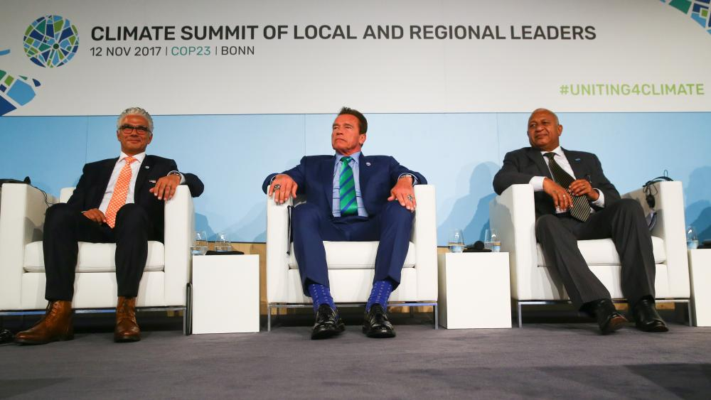 Mayor of Bonn Ashok-Alexander Sridharan, former California Governor Arnold Schwarzenegger, and COP 23 President Prime Minister Frank Bainimarama of Fiji attend the COP23 UN Climate Change Conference, in Bonn, Germany, November 2017. (Reuters)