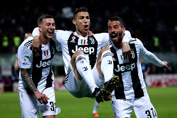 b2526819b Cristiano Ronaldo of Juventus FC celebrates with his teammates Federico  Bernardeschi and Leonardo Spinazzola after scoring a goal during the Serie  A ...